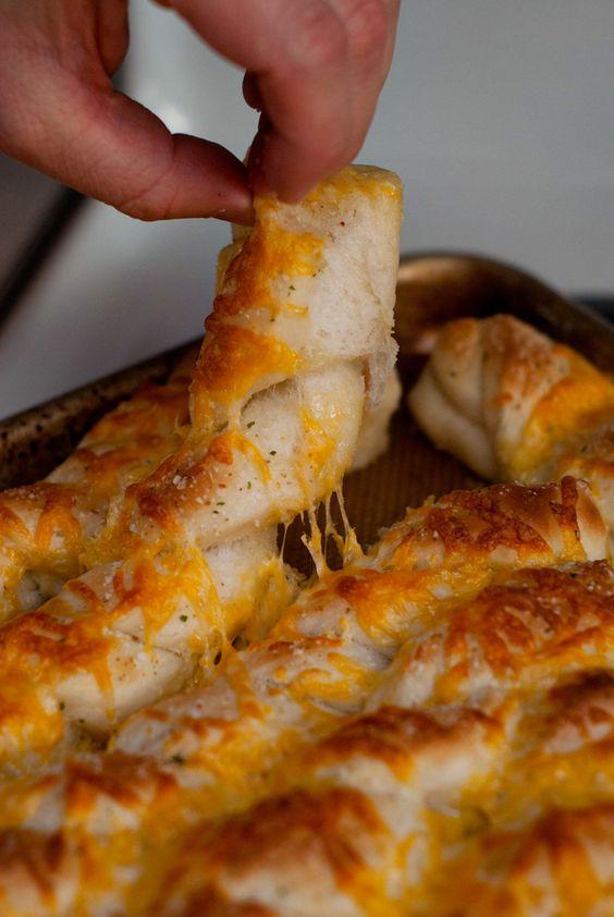 Soft and Cheesy Garlic Breadsticks | http://www.heatherlikesfood.com ...