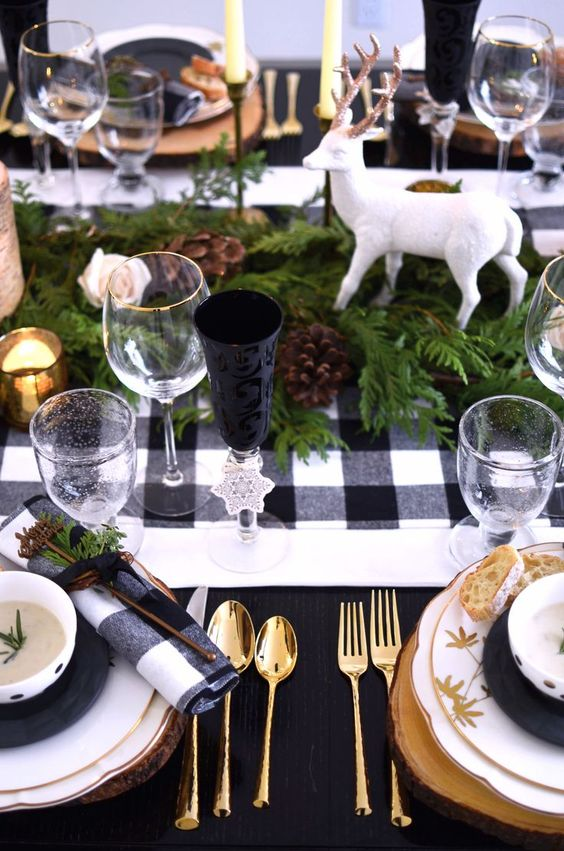 Rustic holiday black and white buffalo plaid table setting with green and wooden charger plates // shot by The Style Safari