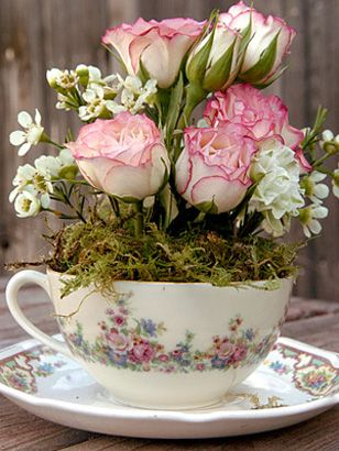 Simple centerpiece using vintage tea cup and saucer...