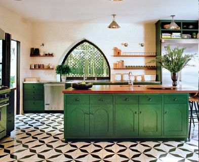 Kitchen tile and cabinets-emerald green base cabinets, black and white patterned tile, white backsplash, gold accents, gold lighting