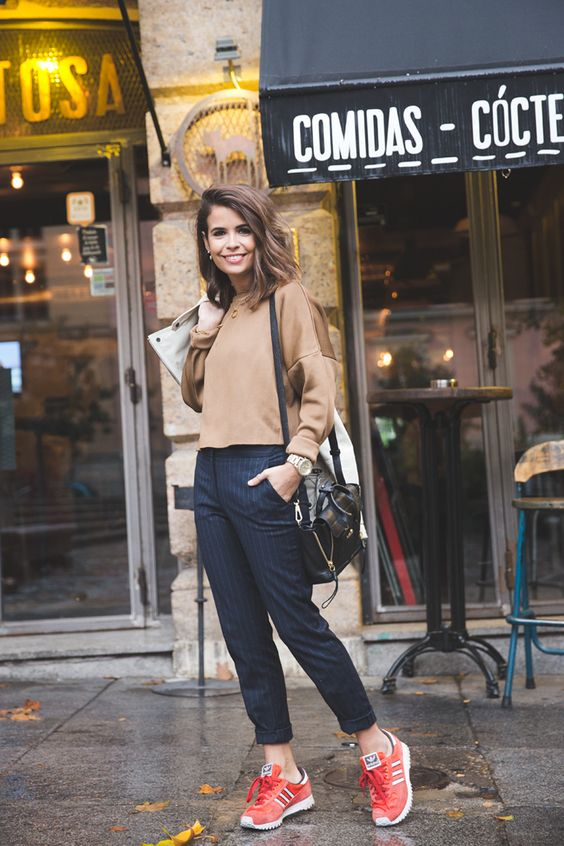 cropped brown sweatshirt, pinstripe trouser / joggers and red sneakers.: