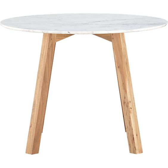 Or maybe this one to add a touch of marble to our kitchen...  CB2 RockDiningTable