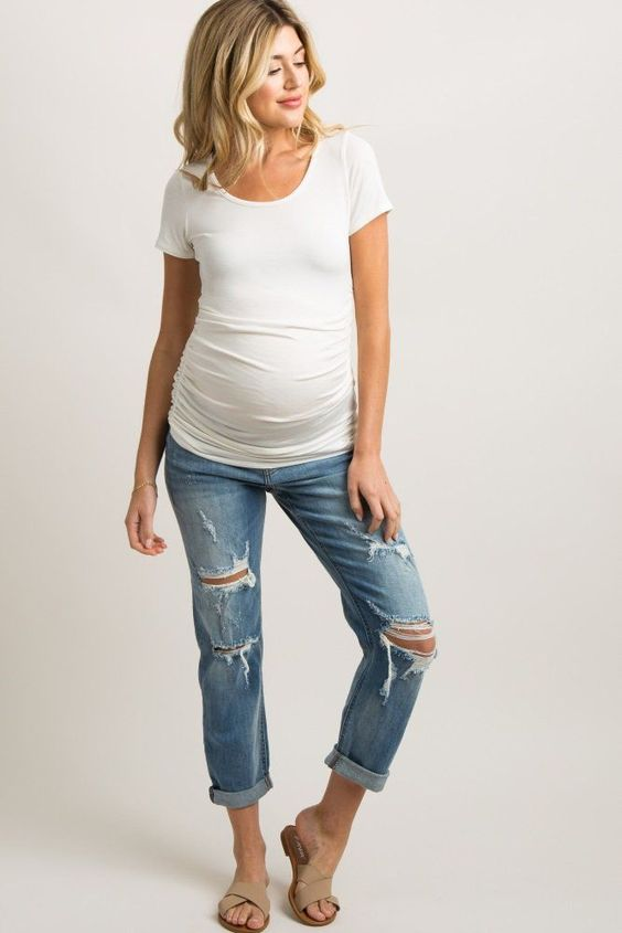 Light Blue Distressed Cuffed Cropped Maternity Jean Light wash distressed, cropped maternity jeans featuring a cuffed hem, five pockets, and an elastic belly band. Material has little stretch. - Baby Bump Fashion - Maternity Dresses to Wear During Pregnancy - Pregnancy Style - Pregnant Mom Fashion