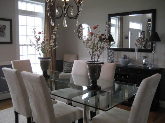 Soft colors in dining room with contemporary and traditional mix...  , Modern glass top table with a traditional chandie and credenza.  The upper all is Athena by BM and the lower wall is Iris by BM.        ,     , Dining Rooms Design