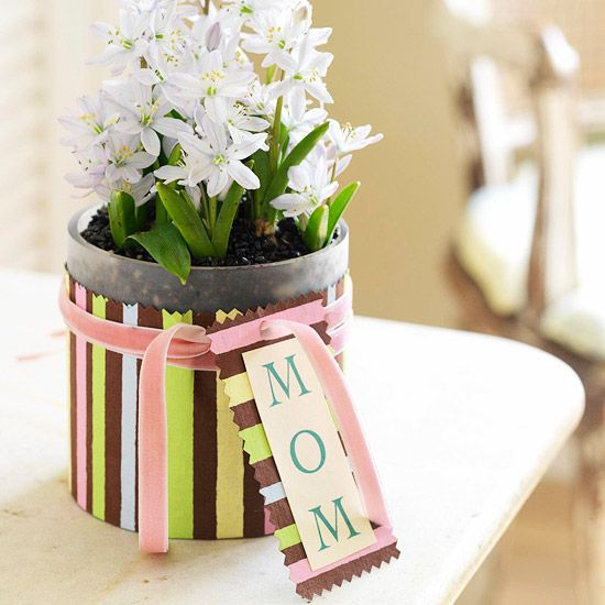 Wrapped Flowerpot        A quick wrap of decorative paper dresses up a simple cylinder planted with bulbs or filled with cut flowers. Pinked edges, a bit of ribbon, and a tag make the gift extra special.