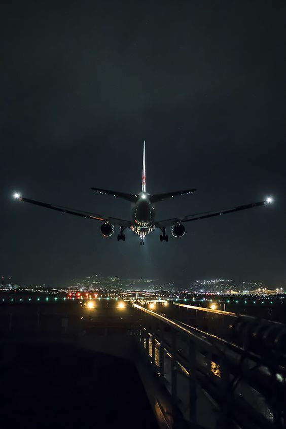 A Passenger Airliner On Approach And About To Touch Down On The