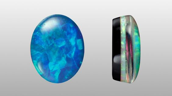 A triplet contains two or more segments of a gem, or different gems, that are joined by layers of glue. In a profile view, this image shows a thin seam of opal in the centre that is backed by dyed black chalcedony, and is overlaid (the domed area) by a quartz cabochon.: