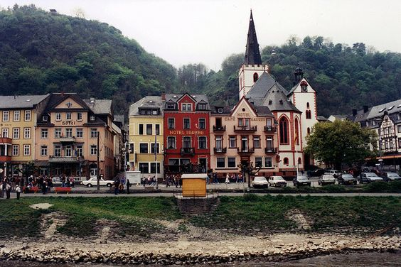 The Middle Rhine Valley in Germany is lined with numerous towns at water level and fortresses on the highest points.