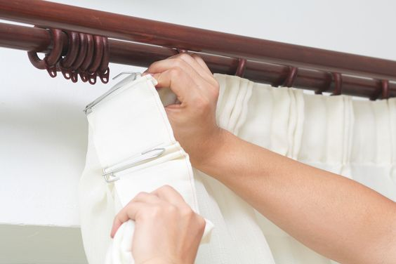 How to put up a curtain track or pole