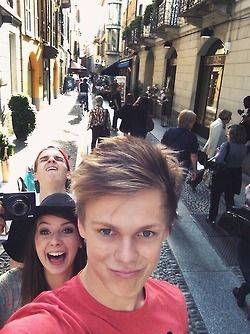 Caspar doing a duck face and Joe and Zoe are photobombing ...