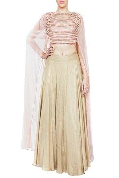 Featuring a blush pink soft net dupatta blouse with chain link and beads thread embroidery and floral applique work on shoulders. It comes along with a gold foil georgette lehenga with shantoon lining By RIDHIMA BHASIN .Shop now-www.carmaonli... #carma #c