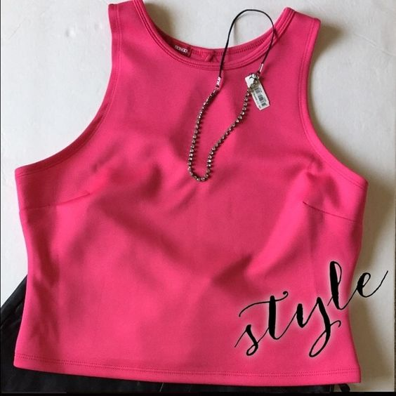 Cute Pink Crop Top This Crop top is fitted with a teardrop cutout in back. It's 95% Polyester and 5% Spandex. This is a size Large in Juniors, runs small BONGO Tops Crop Tops