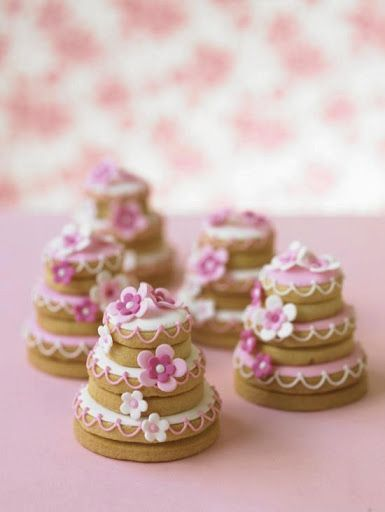 Cookies stacked on each other to make mini wedding cakes, could be cute if done…: