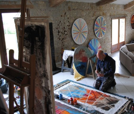 Ian painting hammocks that will be displayed in the streets and public buildings of Valence D'Agen in July, August and September