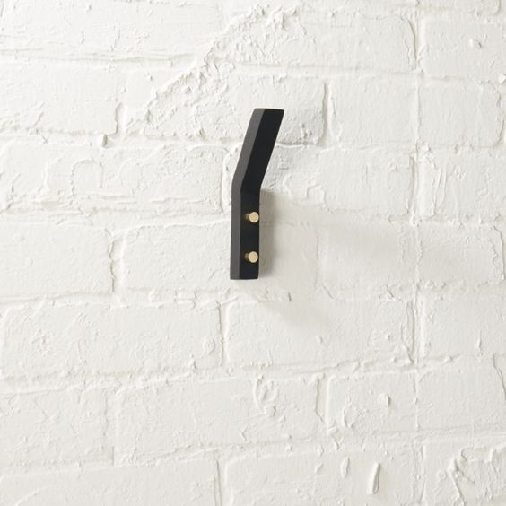 leaning edge matte black wall hook.