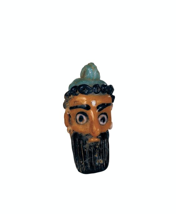 Phoenician glass pendant in the shape of a man's head, 7th-5th cents. BC. Corning Museum of Glass