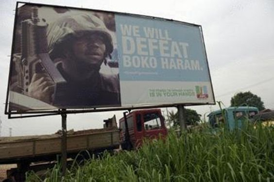 Picture shows a campaign signboad displayed by the ruling All Progressives Congress (APC)in Ogijo, Ogun State in southwest Nigeria, on July 3, 2015/AFP