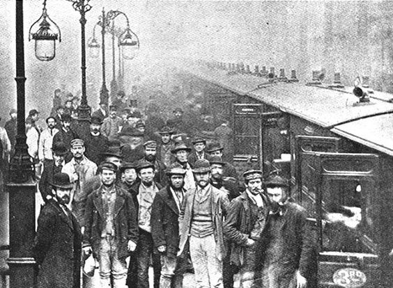 Working class hats - Liverpool Street Station, Bishopsgate, London. Workingman traveling by the 12:55 p.m. train to Enfield Town. 25 October 1884.