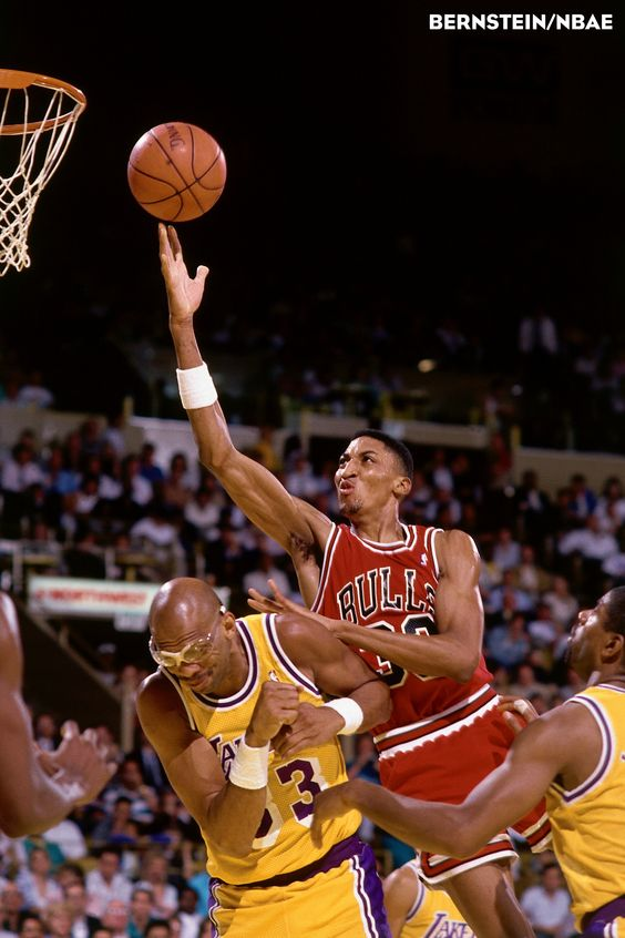Scottie Pippen blows past the great Kareem Abdul-Jabaar for a basket. Photo courtesy of NBAE/Andrew Bernstein.