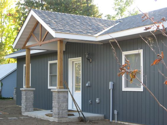 Lake side cottage finished with midnight surf board and for Cottage exterior siding ideas