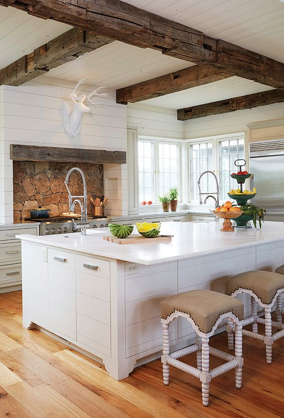 Country Kitchen with Wooden Beam Ceiling. Country kitchen boasts white plank ceiling dotted with rustic wood beams. #CountryKitchen #BeamCeiling Birmingham Home and Garden: