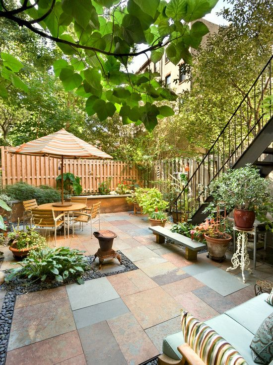 small backyard patio garden in the city by tobin