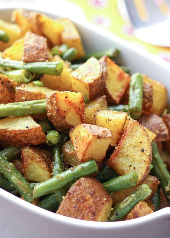 Turmeric Roasted Potatoes with Green Beans are a great side dish for any occasion! Omit the cheese for #Whole30