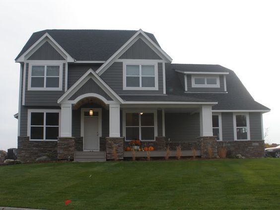 Like the gray siding with thick white trim placement of the stone but not that stone - Thick exterior paint concept ...