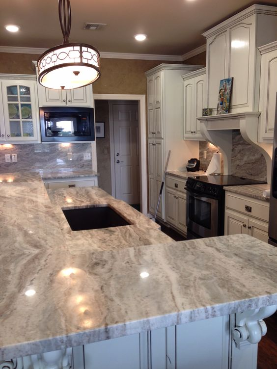 polished fantasy brown quartzite kitchen counters and full height backsplash considered a soft quartzite or hard marble visit globalgranitecom for