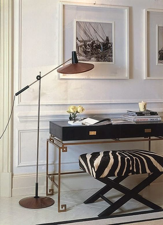 traditionally decorated white foyer black console table gold zebra benches