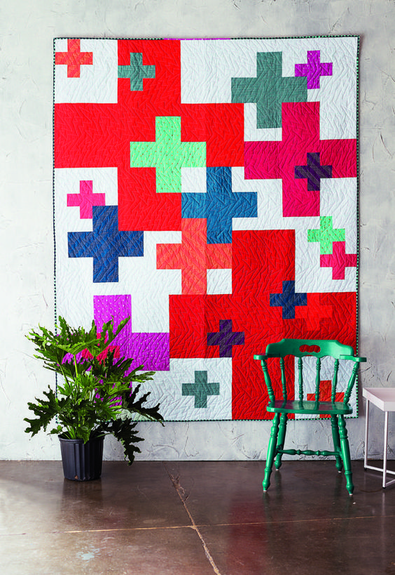 Add It Up is a contemporary quilt that features bright colored plus signs in various sizes place randomly across the quilt. Click for digital pattern.