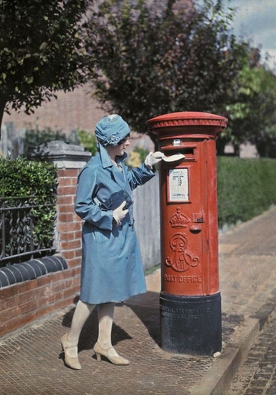 This shot from 1928 is one of my favourite autochrome photos of all time. I just love how vivid her blue outfit and the red mailbox are. #vintage #1920s #UK: