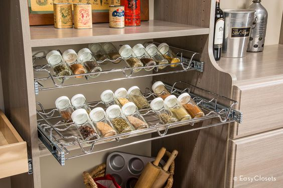 Simplify meal prep by keeping spices at the ready in their own special rack. The Chrome rack slides out easily on full extension glides and tucks away in your pantry when it's not in use.