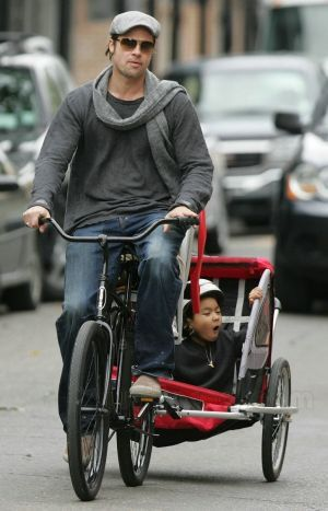 Brad Pitt on a bike. An e-bike? Whatever it is, it's sustainable, and the kid looks like it's enjoying the adventure!