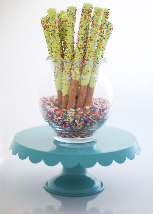 Chocolate, I mean, Icing Covered Pretzels · Edible Crafts | CraftGossip.com. Try it w/ White frosting & 4th of july colored sprinkles. Sparklers!