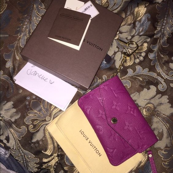 "Louis Vuitton empreinte key pouch Sold out color ""GRAPE"" bought last month,find it not practical for my mommy duties. Beautiful color..a MUST have!! Comes w everything in pic. Only ONLY flaw is the minor hairline scratches on brass parts. $435+ship on M3r Louis Vuitton Accessories Key & Card Holders"