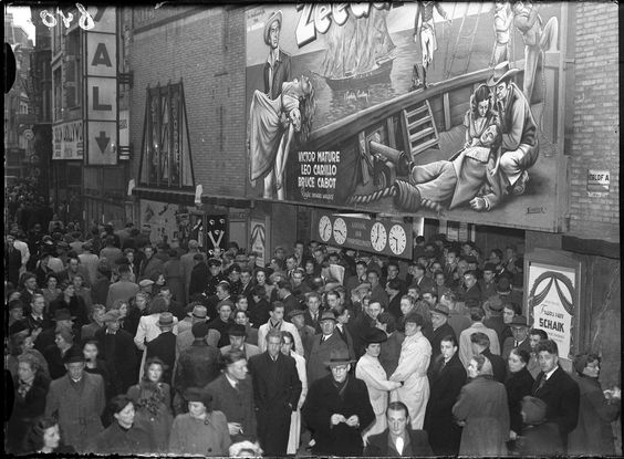 1946. A crowd gathered in front of movie theater Cinema Royal at the Nieuwendijk in Amsterdam for a showing of the movie Zeeduivels (Captain Caution) with Victor Mature, Leo Carillo en Bruce Cabot. Photo AHF Collectie IISG / Ben van Meerendonk. #amsterdam #1946 #CinemaRoyal