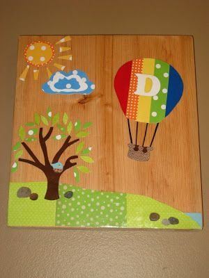 Your baby will love the bright colors and fun cut outs on this DIY nursery wall art!