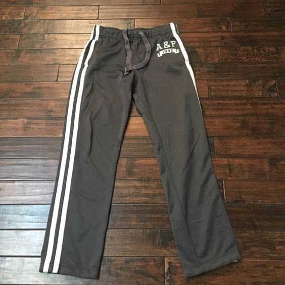 Gray workout pants with white stripes Gray workout or lounge pants with white stripes down the sides and has pockets. Also has a pocket in the back on the right. Logo on front of left hip. Abercrombie & Fitch Pants Track Pants & Joggers