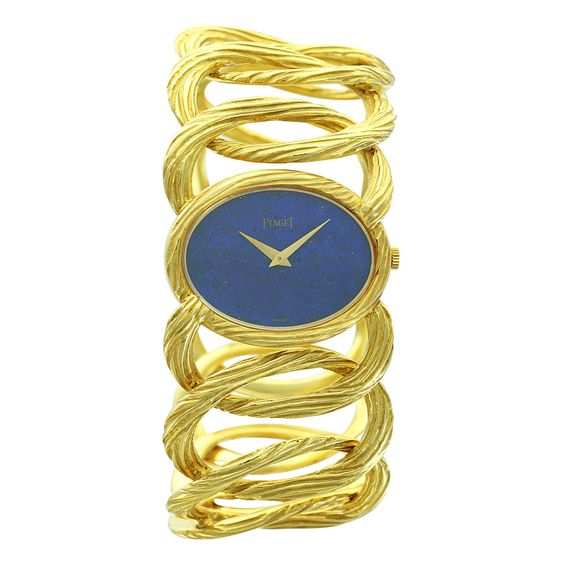 My aunt had this watch and it went missing when she passed away. She had such style. Piaget Lady's Yellow Gold Rope Link Band Bracelet Watch