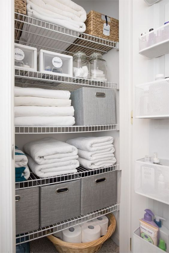 Hallway Linen Closet Organization Ideas - how to make the most of your small linen closet with these tips!
