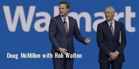 Doug McMillon, left, ceo of Walmart store,inc., is speaking with Rob walton.