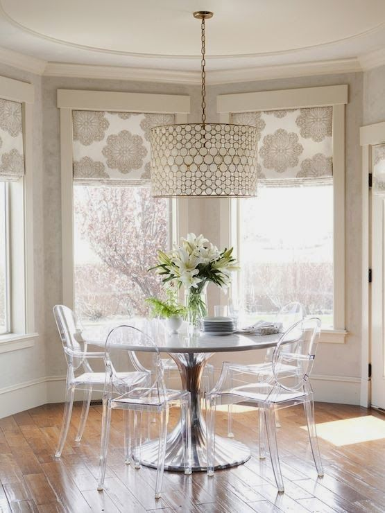Breakfast room with modern round table and Louis ghost chairs. Beautiful Classically Refined Rooms on Hello Lovely Studio. #ghostchair #acrylic #chair