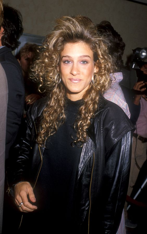 1988: Feathered Bangs Among other stars, Sarah Jessica Parker rocked this incredibly '80s do, inspiring American women to follow suit by teasing their bangs and perming their locks.:
