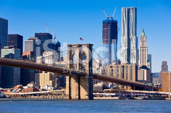 NEW- Brooklyn bridge with Manhattan buildings in background royalty-free stock photo