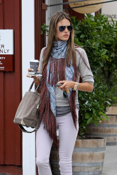 Alessandra Ambrosio Photos Photos - Alessandra Ambrosio, wearing a gray sweater and blue scarf, warms up with a coffee to go in Los Angeles. - Alessandra Ambrosio Makes a Coffee Run in LA: