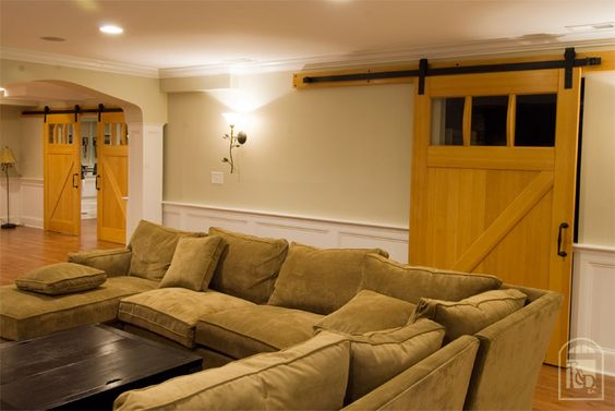 basement idea barn door separates the gym from living