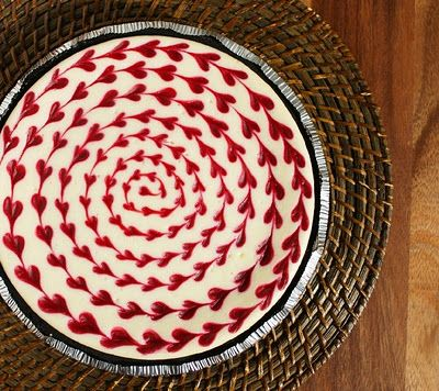 White Chocolate Raspberry Cheesecake (Valentine's Dessert)..drag a toothpick through a dot of red!