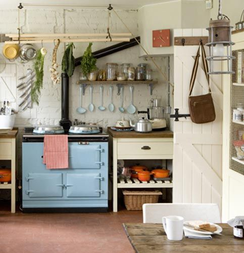 """Freestanding kitchen units: """"Mixing a variety of free standing kitchen surfaces creates a homey environment that mimics the way we decorate in the rest of the home. You rarely walk into a living room where every piece of furniture is made out of the same type of material."""""""