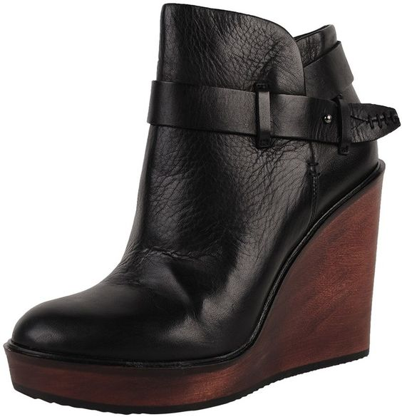 """Dolce Vita Colie - The Colie is a round toe leather boot with natural wood wedge heel. Strap and buckle accent. Zipper and knob closure. Heel Height: 4-1/4"""""""